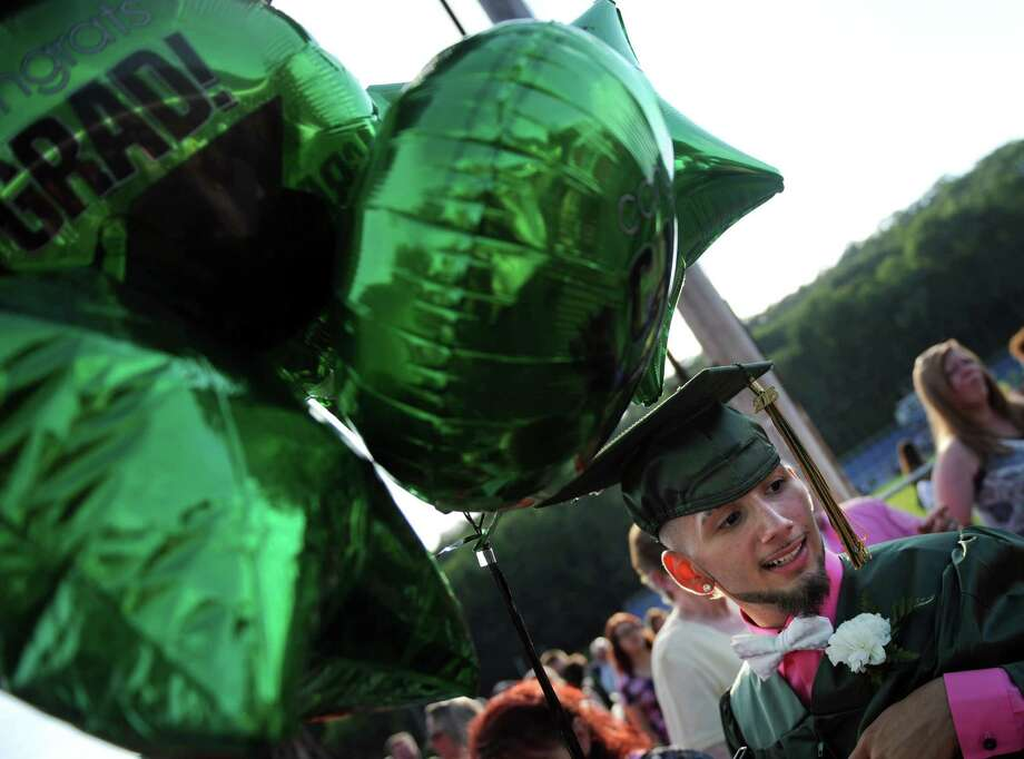 Emmett O'Brien Technical High School holds its commencement ceremony Friday, June 19, 2015 on Nolan Field in Ansonia, Conn. Photo: Autumn Driscoll, Hearst Connecticut Media / Connecticut Post