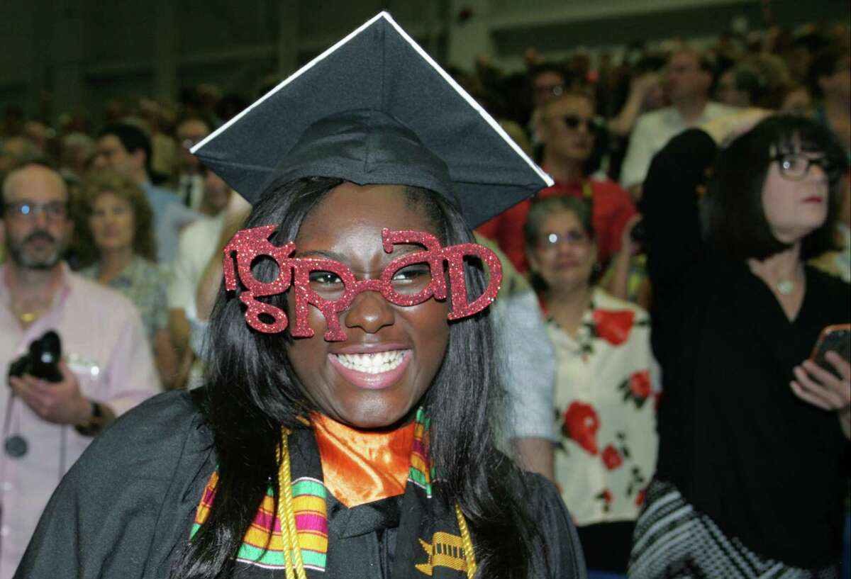 Jacinta Utubor sports grad glasses as she and fellow graduates enter for the 2015 Ridgefield High School commencement at the William A. O'Neill Center on the campus of Western Connecticut State University in Danbury on Friday.