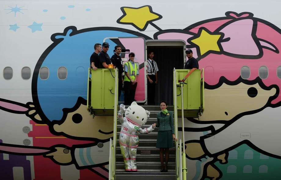 Hello Kitty greets fans from EVA Air's Hello Kitty Shining Star Jet at an event celebrating its premiere Friday, June 19, 2015, in Houston. Photo: Jon Shapley, Houston Chronicle / © 2015 Houston Chronicle