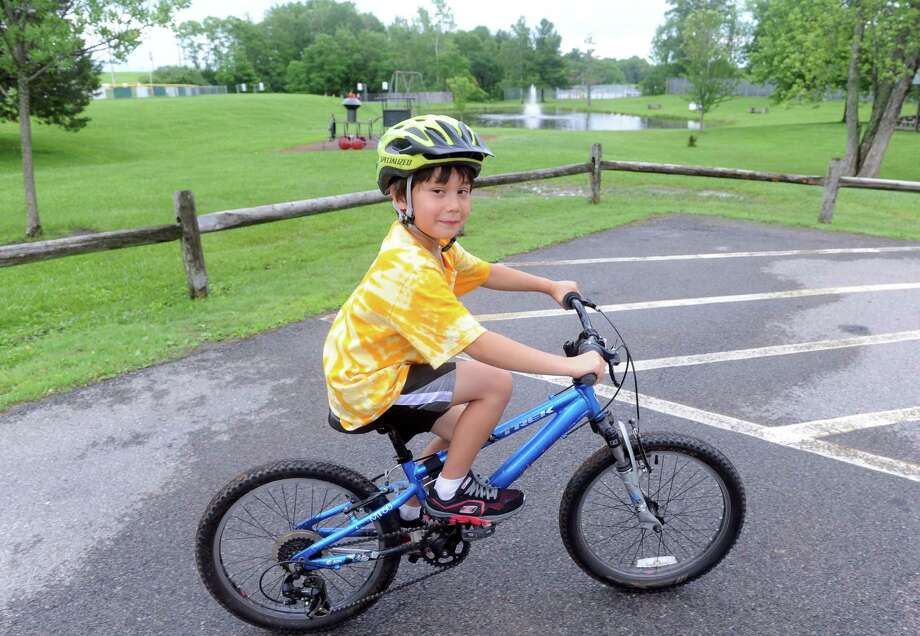 Seven-year-old Teddy Corwin of Niskayuna helped his family raise $1,200 that was presented to the BOE to used to rebuild the old playground at Birchwood Elementary on Tuesday, June 16, 2015, in Niskayuna, N.Y.  (Michael P. Farrell/Times Union) Photo: Michael P. Farrell / 00032282A