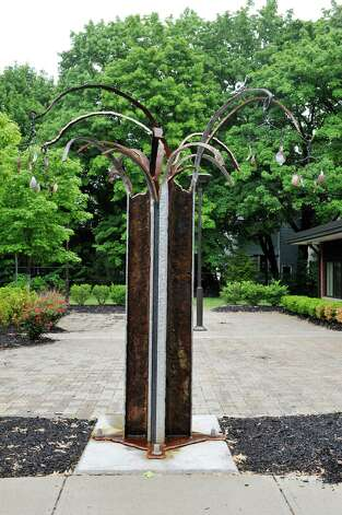 A view of the artwork created by sculptor Matt Hart outside the Albany Library Delaware Ave. Branch on Tuesday, June 2, 2015, in Albany, N.Y.  The sculpture is made of old trolley rails salvaged when Delaware Avenue was reconstructed.   (Paul Buckowski / Times Union) Photo: PAUL BUCKOWSKI / 00032094A