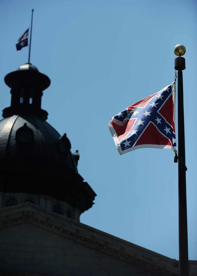 The Confederate flag flies over a memorial near the South Carolina capitol. It was moved from the capitol dome in 2000. Photo: Rainier Ehrhardt, FRE / FR155191 AP