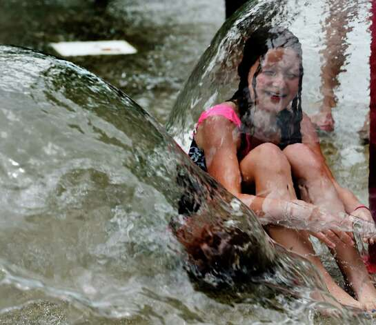 Jennifer Marra, 10, of A. W, Becker Elementary School from Selkirk sits under a water umbrella on the last full day of class and the day before the first day of summer at the Elm Avenue Park Friday afternoon, June 19, 2015, in Bethlehem, N.Y. (Skip Dickstein/Times Union) Photo: SKIP DICKSTEIN