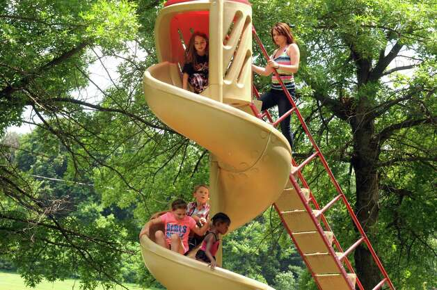 Children use the slide en masse at Frear Park on Friday June 19, 2015 in Troy, N.Y.  (Michael P. Farrell/Times Union) Photo: Michael P. Farrell