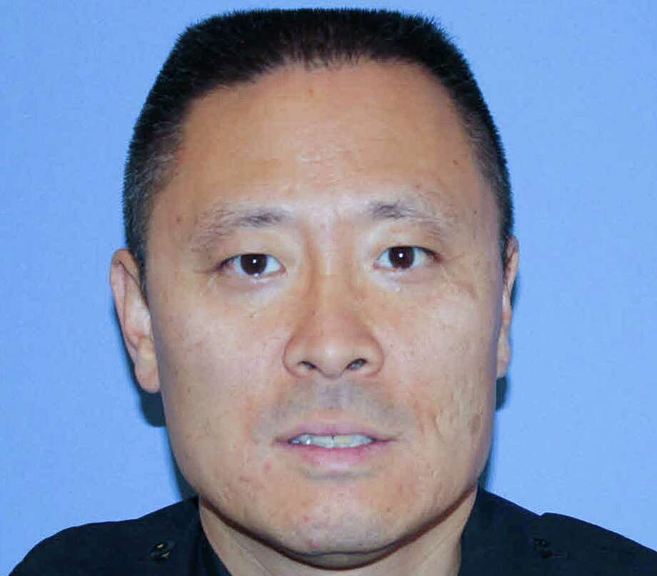 This undated photo released by the Cincinnati Police Department, shows Officer Sonny Kim. Kim, a decorated 27-year veteran of the Cincinnati Police Department, died along with a suspect while responding to a 911 call about an erratic armed man shortly before 9:30 a.m. in the Madisonville neighborhood, Police Chief Jeffrey Blackwell said. Both died at a Cincinnati hospital. (Cincinnati Police Department via AP) Photo: HOGP / Cincinnati Police Department