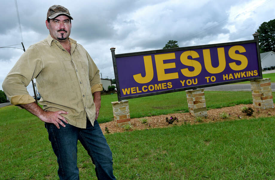 Hawkins Mayor Will Rogers says this sign welcoming visitors to the small Wood County community is privately owned but many support its message. Photo: Andrew D. Brosig, MBR / The Tyler Morning Telegraph