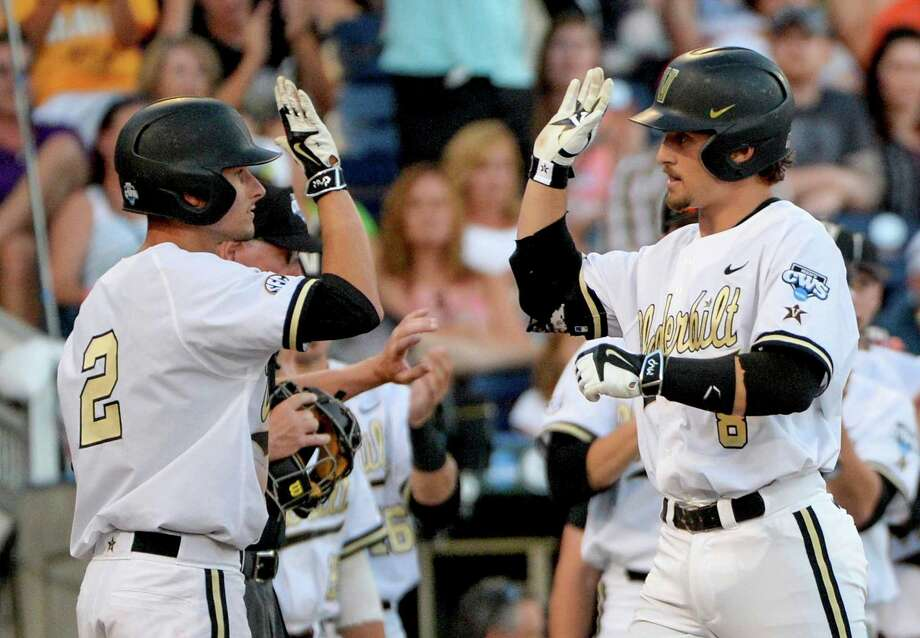 Vanderbilt's Rhett Wiseman, right, connects with Tyler Campbell, who scored on Wiseman's two-run homer in the fourth inning of Friday night's elimination game against TCU. Photo: Ted Kirk, FRE / FR34398 AP