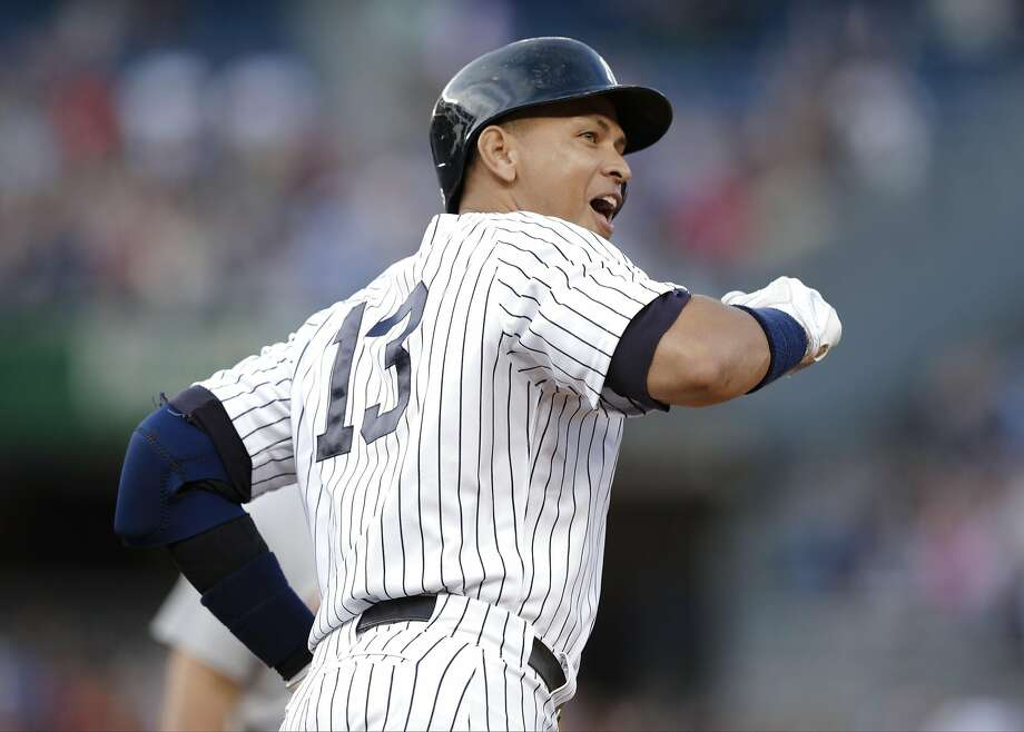New York Yankees' Alex Rodriguez gestures to the crowd after hitting a home run for his 3,000th career hit, during the first inning of a baseball game against the Detroit Tigers on Friday, June 19, 2015, in New York. (AP Photo/Frank Franklin II) Photo: Frank Franklin II, Associated Press