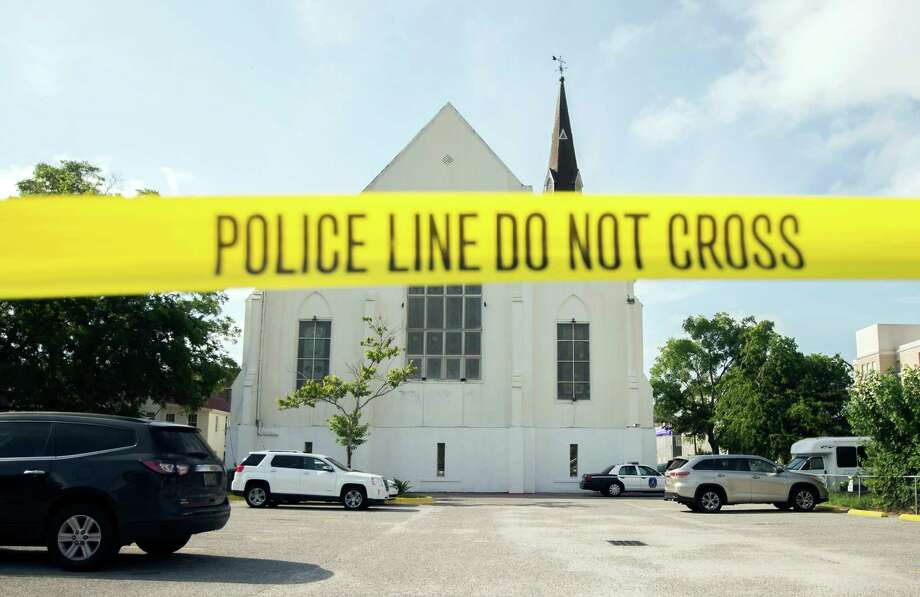 Police tape surrounds the parking lot behind the AME Emanuel Church as FBI forensic experts work the crime scene Friday in Charleston, S.C.    Dylann Storm Roof, 21, is accused of killing nine people during a Wednesday night Bible study at the church.  Photo: Stephen B. Morton, FRE / FR56856 AP