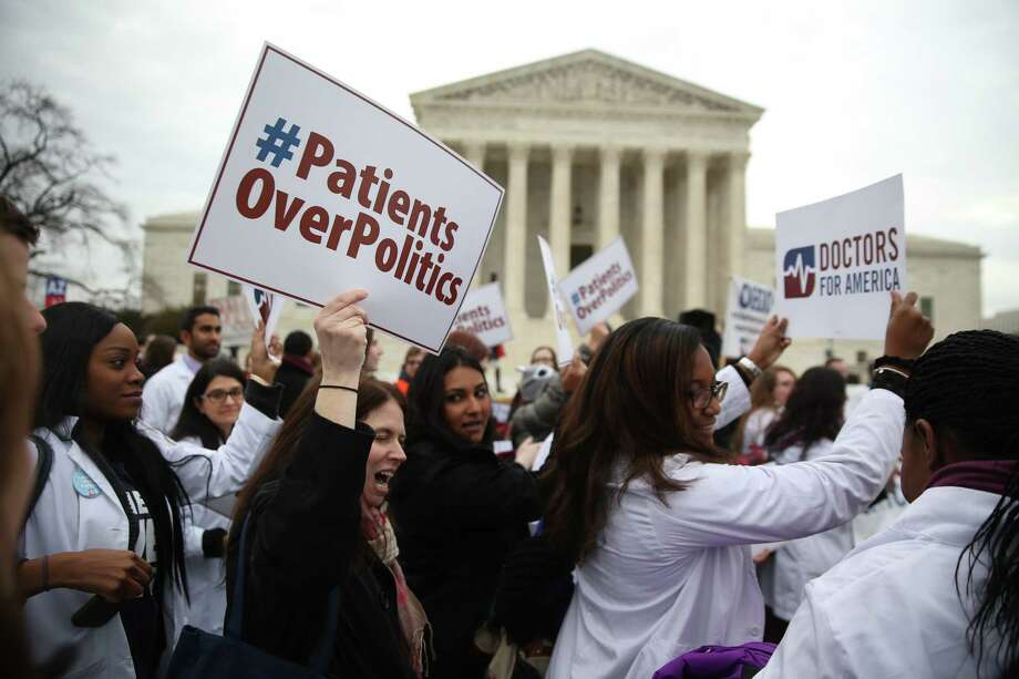 Demonstrations outside the U.S. Supreme Court, where a challenge to the Affordable Care Act was heard in March.  Photo: DOUG MILLS, STF / NYTNS