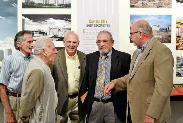 Tradesmen, from left, Andy Mantello, Tom Marinello, Joe Salerno, Joseph Roberti and Kevin Hicks, who worked on the original construction 50-years-ago preview the new NYS Museum Empire State Plaza at 50 Exhibit at the museum Friday June 19, 2015 in Albany, NY. (John Carl D'Annibale / Times Union) Photo: John Carl D'Annibale / 00032343A