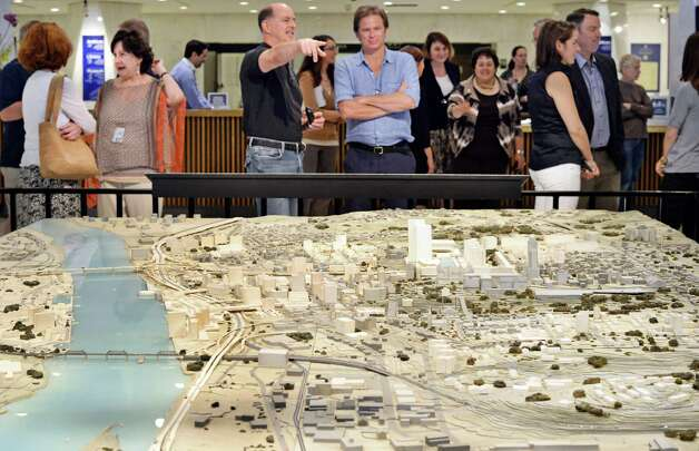Preview attendees view a model and timeline at the NYS Museum's new Empire State Plaza at 50 Exhibit Friday June 19, 2015 in Albany, NY. The exhibit officially opens to the public on June 21.(John Carl D'Annibale / Times Union) Photo: John Carl D'Annibale / 00032343A