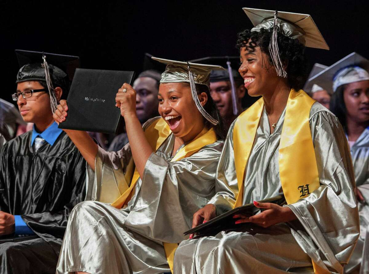 Cedilece Frazier holds up her diploma during The Bridge Academy eighteenth annual commencement ceremony held at the Thurgood Marshall Middle School, Bridgeport, CT on Friday, June 19, 2015.