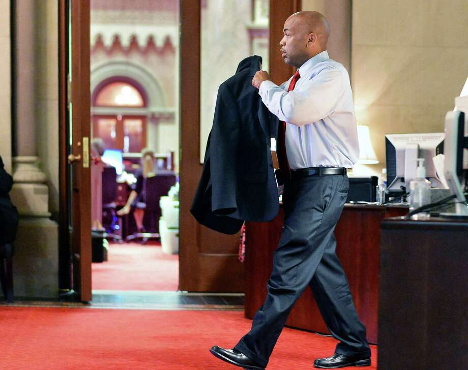 Assembly speaker Carl Heastie pulls on his suit coat as he leaves his office at the Capitol Friday, June 19, 2015, in Albany, N.Y.  (John Carl D'Annibale / Times Union) Photo: John Carl D'Annibale / 00032347A