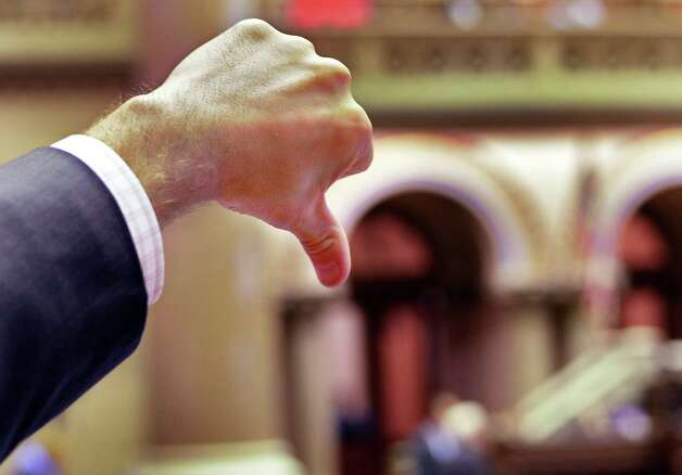 """An Assembly member casts a """"no"""" vote during session at the Capitol Friday June 19, 2015 in Albany, NY.  (John Carl D'Annibale / Times Union) Photo: John Carl D'Annibale / 00032347A"""