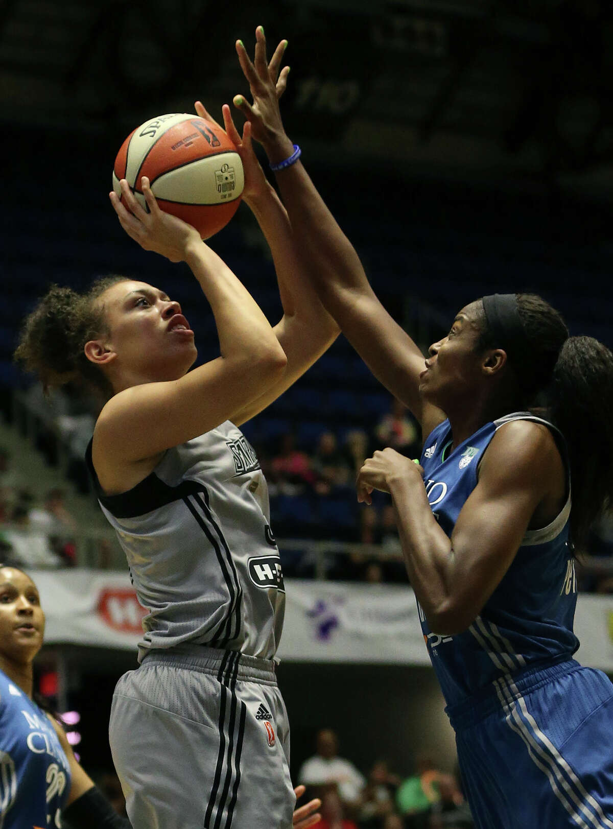 Dearica Hamby tries a shot against stiff defense put up by Devereaux Peters as the San Antonio Stars host the Minnesota Lynx at Freeman Coliseum on June 19, 2015.