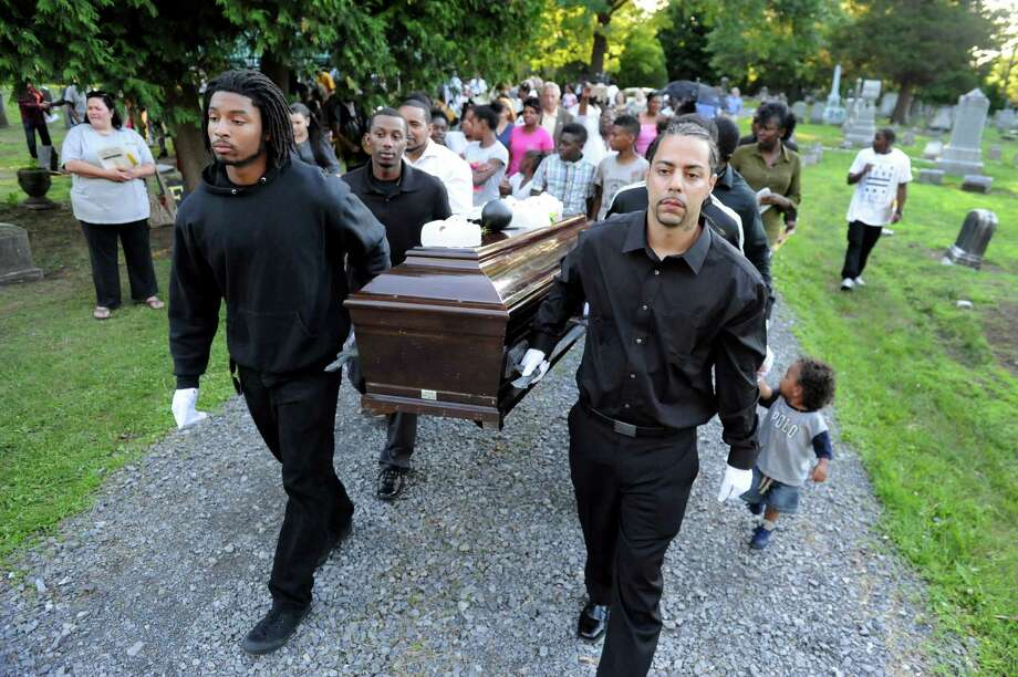 Pallbearers carry a casket during a Funeral for Crime and Violence from the African American Burial Ground as part of Juneteenth events on Friday, June 19, 2015, at Vale Cemetery in Schenectady, N.Y. (Cindy Schultz / Times Union) Photo: Cindy Schultz / 00032342A