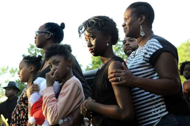 Zuri Kai Keith, 11, center, of Schenectady joins her mother, Ka'Turay Koroma, right, during a Funeral for Crime and Violence from the African American Burial Ground as part of Juneteenth events on Friday, June 19, 2015, at Vale Cemetery in Schenectady, N.Y. (Cindy Schultz / Times Union) Photo: Cindy Schultz / 00032342A