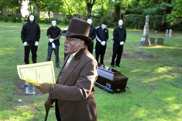 Walter Simpkins, center, portrays Moses Viney, who's buried in the African American Burial Ground, during a Funeral for Crime and Violence from the as part of Juneteenth events on Friday, June 19, 2015, at Vale Cemetery in Schenectady, N.Y. Viney was a runaway slave from Maryland who settled in Schenectady. (Cindy Schultz / Times Union) Photo: Cindy Schultz / 00032342A