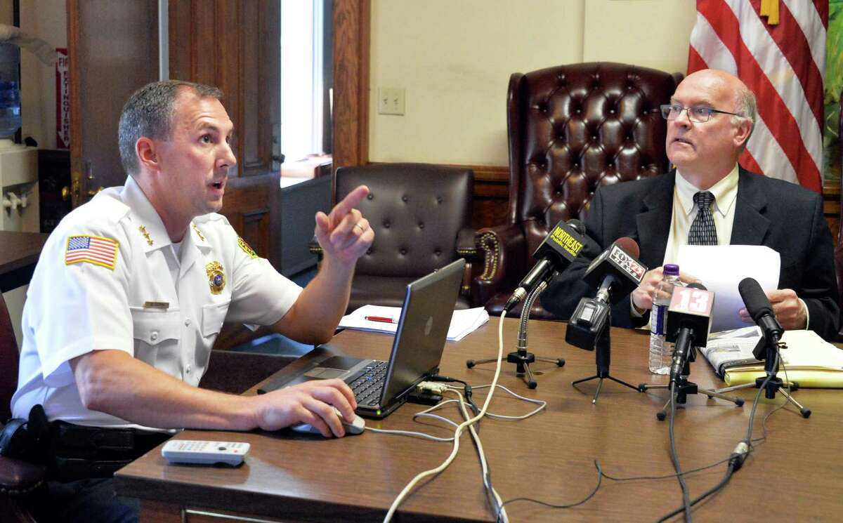 Saratoga Springs Police Chief Greg Veitch, left, and Public Safety Commissioner Chris Mathiesen show a video relating to the Darryl Mount Jr. case during a news conference at City Hall Friday, June 20, 2014, in Saratoga Springs, N.Y. (John Carl D'Annibale / Times Union archive)