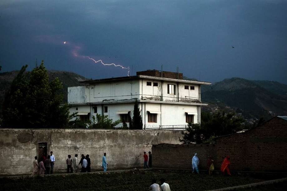 FILE - Lightening strikes in the distance beyond the compound where Osama Bin Laden was killed, in Abbottabad, Pakistan, May 4, 2011. From the moment it was announced to the public, the tale of how Osama bin Laden met his death has been a changeable feast. The latest contribution is the journalist Seymour Hersh's 10,000-word article in The London Review of Books. (Warrick Page/The New York Times) Photo: WARRICK PAGE, STR / New York Times / NYTNS