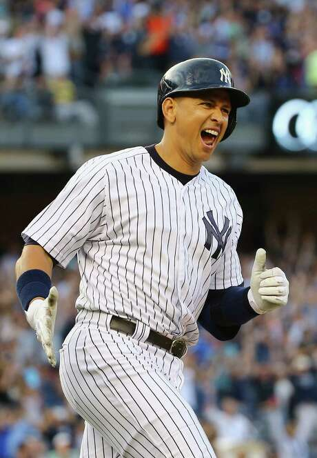 NEW YORK, NY - JUNE 19:  Alex Rodriguez #13 of the New York Yankees celebrates after hitting a home run as well as getting his 3000th career hit in the first inning against the Detroit Tigers during their game at Yankee Stadium on June 19, 2015 in New York City.  (Photo by Al Bello/Getty Images) Photo: Al Bello, Staff / 2015 Getty Images