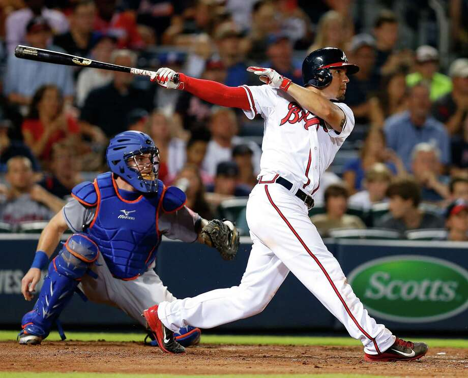 ATLANTA, GA - JUNE 19:  Second baseman Jace Peterson #8 of the Atlanta Braves hits a 2-run double in the eighth inning while catcher Kevin Plawecki #22 of the New York Mets looks on during the game at Turner Field on June 19, 2015 in Atlanta, Georgia.  (Photo by Mike Zarrilli/Getty Images) ORG XMIT: 538582965 Photo: Mike Zarrilli / 2015 Getty Images