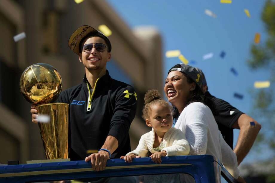Everybody loves a parade, including 2-year-old Riley Curry, who had a front-row seat along with her father Stephen and mother Ayesha for Friday's victory parade in Oakland, Calif., honoring the NBA champion Golden State Warriors. Photo: Stephen Lam, Stringer / 2015 Getty Images