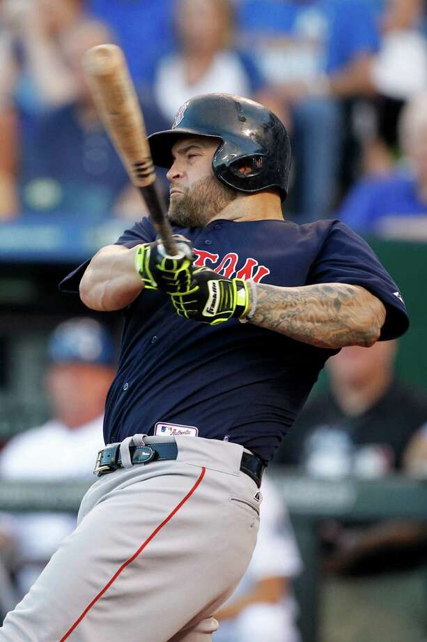 Boston Red Sox' Mike Napoli hits in the fourth inning of a baseball game against the Kansas City Royals at Kauffman Stadium in Kansas City, Mo., Friday, June 19, 2015. (AP Photo/Colin E. Braley) ORG XMIT: MOCB116 Photo: Colin E. Braley / FR123678 AP