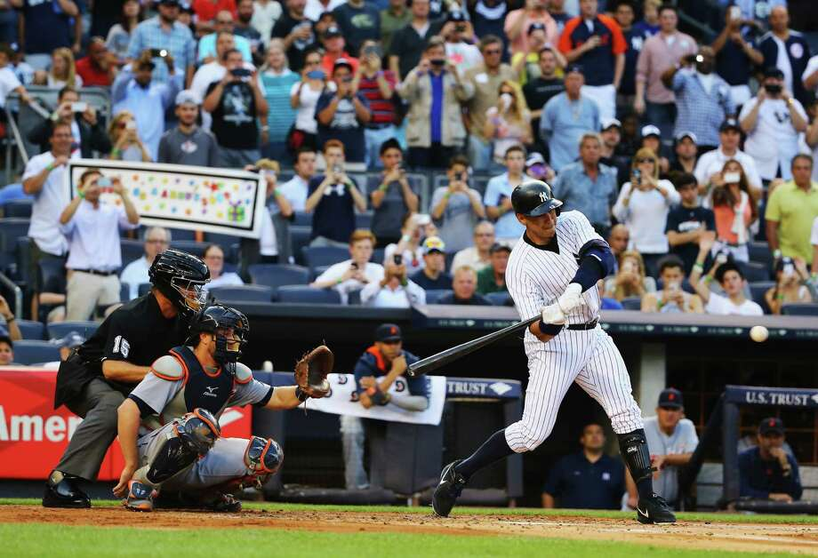 NEW YORK, NY - JUNE 19:  Alex Rodriguez #13 of the New York Yankees hits a home run as well as getting his 3000th career hit in the first inning against the Detroit Tigers during their game at Yankee Stadium on June 19, 2015 in New York City.  (Photo by Al Bello/Getty Images) ORG XMIT: 538582699 Photo: Al Bello / 2015 Getty Images