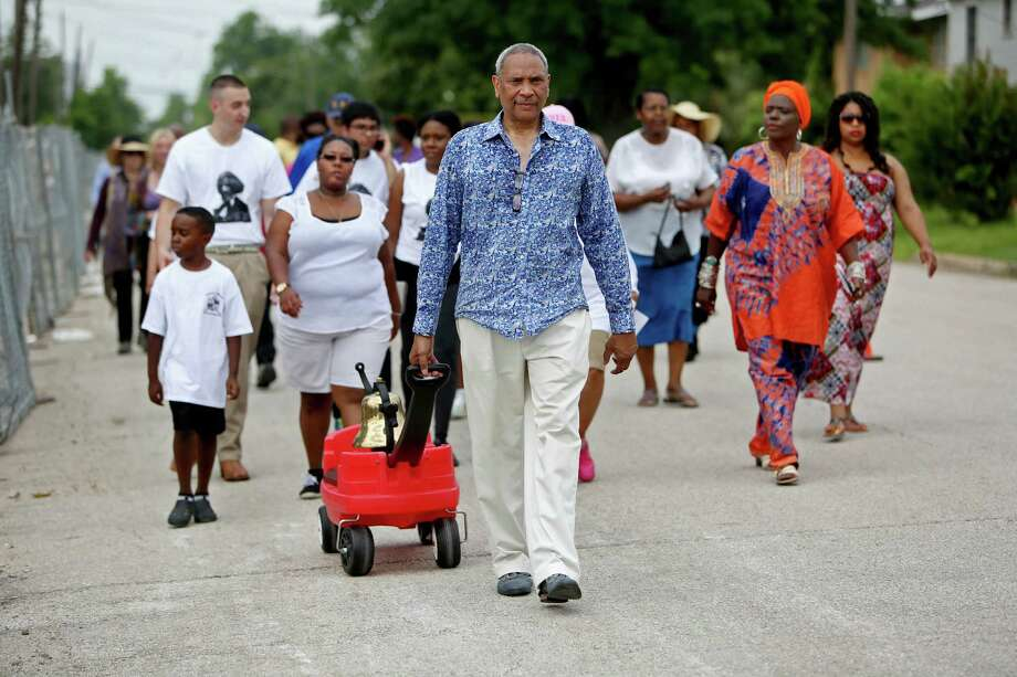 John Guess, CEO of the Houston Museum of African American Culture, leads a Juneteenth prayer vigil and drum call march around Emancipation Park to bless the park's new construction and anticipated 2016 rebirth Friday, June 19, 2015, in Houston. At each corner ministers from twelve churches will pray and pay tribute to one of the park's 4 founders: Rev. Jack Yates, Richard Brock, Richard Allen and Rev. Elias Dibble. Juneteenth is the oldest nationally celebrated commemoration of the ending of slavery in the United States. Photo: Gary Coronado, Houston Chronicle / © 2015 Houston Chronicle