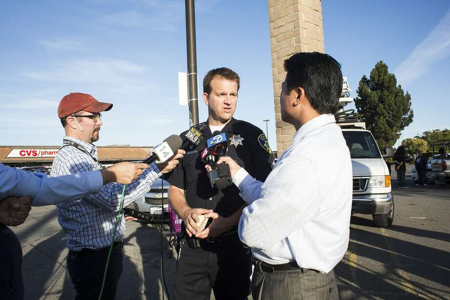 Sergeant M. Nichelini giving a statement to reporters at the scene of an accident where a car went into a bus stop and hit several people, killing one and injuring several others, Vallejo, California,  June 19th, 2015. Photo: Talia Herman, Special To The Chronicle