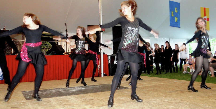 Lenihan School of Irish Dance troupe members perform Friday on the first night of the Fairfield County Irish Festival at Fairfield University. Photo: Mike Lauterborn / For Hearst Connecticut Media / Fairfield Citizen