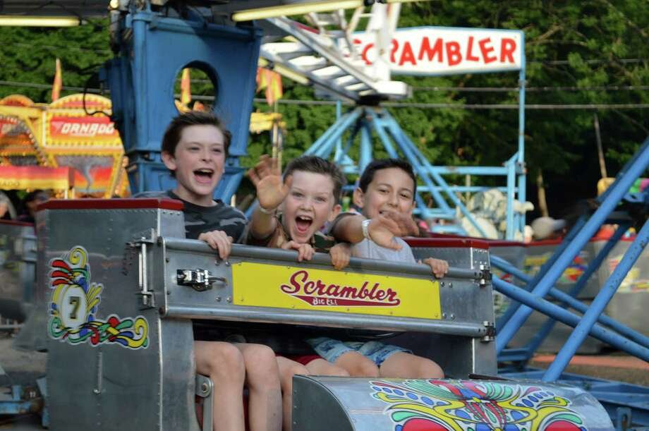 Noah Phillips, Liam Phillips and Domenic Petrosinelli, all of Westport, spun with the fun Friday on the Scrambler ride at the Yankee Doodle Fair at the Westport Woman's Club. Photo: Jarret Liotta / For Hearst Connecticut Media / Westport News