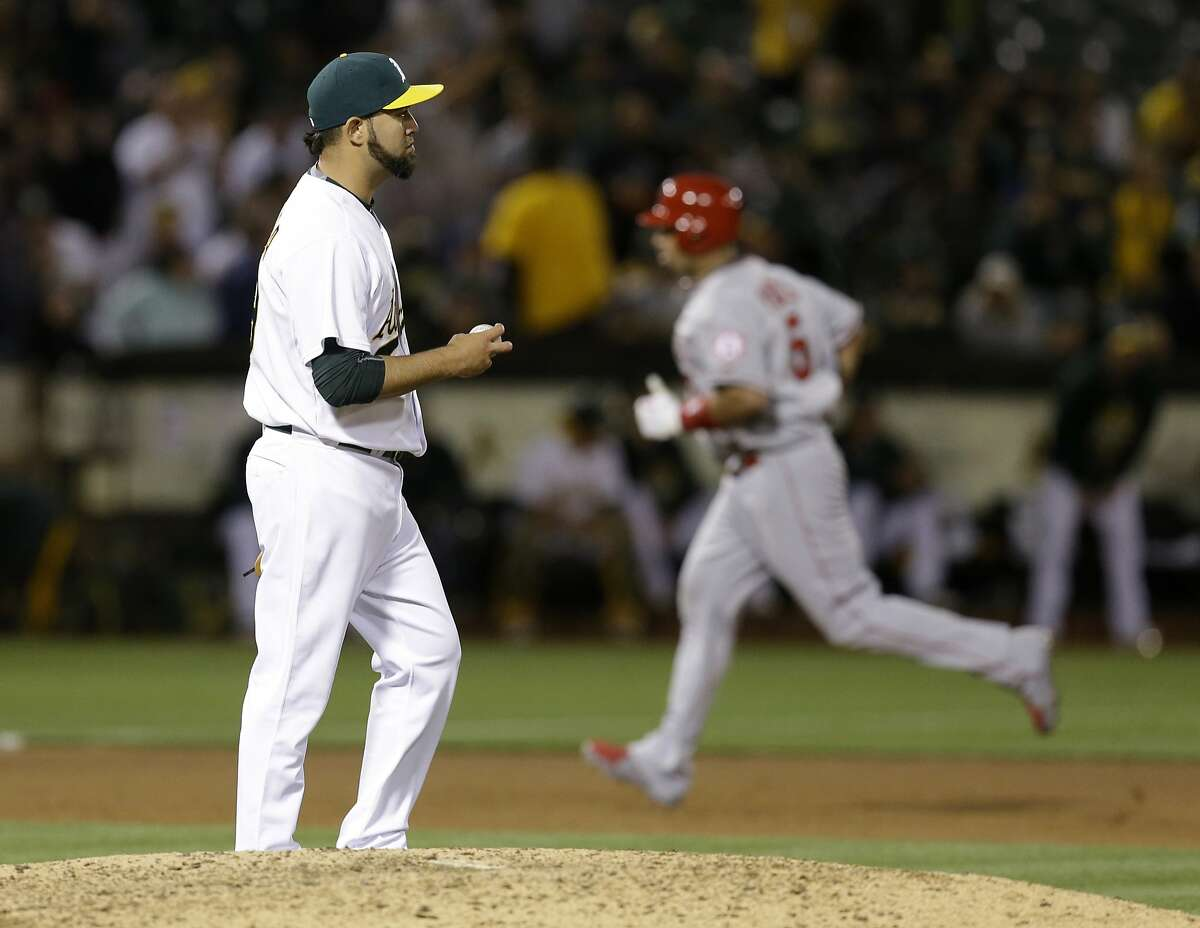 Los Angeles Angels' Albert Pujols Oakland Athletics' Edward Mujica in the seventh inning of a baseball game Friday, June 19, 2015, in Oakland, Calif. (AP Photo/Ben Margot)
