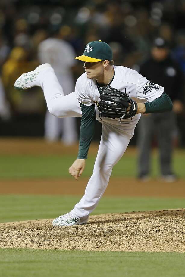 Starting pitcher Sonny Gray #54 of the Oakland Athletics follows through on a pitch against the Los Angeles Angels of Anaheim in the sixth inning at O.co Coliseum on June 19, 2015 in Oakland, California.  The Angels won 12-7, with Gray getting a no decision. Photo: Brian Bahr, Getty Images