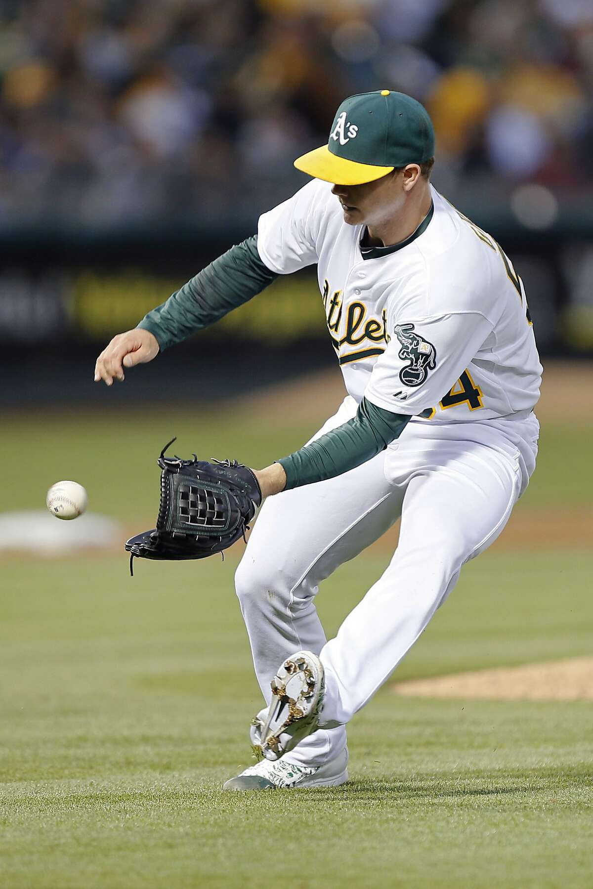 OAKLAND, CA - JUNE 19: Starting pitcher Sonny Gray #54 of the Oakland Athletics stops a ground ball to put out Albert Pujols of the Los Angeles Angels of Anaheim in the sixth inning at O.co Coliseum on June 19, 2015 in Oakland, California. The Angels won 12-7. (Photo by Brian Bahr/Getty Images)