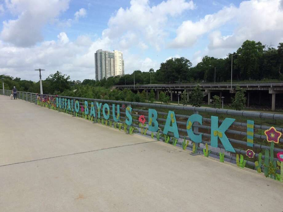 Local Houston knitting group Urban Yarnage created a temporary art installation on Saturday morning at Buffalo Bayou Park. The colorful project celebrates International Yarn Bomb Day and the revitalization of the park. Mary Goldsby with the group told those at the installation Saturday morning that it took nearly 30 people to install the creation, which should be around for the next two or three weeks. The installation can be seen the corner of Allen Parkway and Taft Street right. Photo: Urban Yarnage