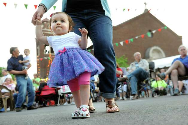 Celeste Angilletta, 14 months, of Colonie moves to the live music with her mother, Jennifer Angilletta, during the annual St. Anthony's Festa on Friday, June 19, 2015, at St. Anthony's Church in Schenectady, N.Y. The event continues on Saturday from 3 to 10 p.m. and Sunday from 2 to 9 p.m. (Cindy Schultz / Times Union) Photo: Cindy Schultz / 00032318A