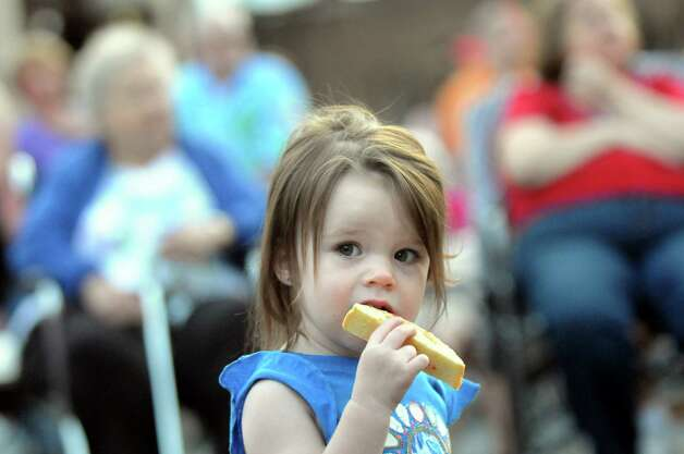 Harper Murphy, 21 months, of Alplaus nibbles on biscotti during the annual St. Anthony's Festa on Friday, June 19, 2015, at St. Anthony's Church in Schenectady, N.Y. The event continues on Saturday from 3 to 10 p.m. and Sunday from 2 to 9 p.m. (Cindy Schultz / Times Union) Photo: Cindy Schultz / 00032318A