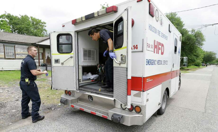 EMTs with the Houston Fire Department prepare to leave after loading a patient into an ambulance while responding to a 911 call Friday, May 15, 2015.  ( Melissa Phillip / Houston Chronicle ) Photo: Melissa Phillip, Staff / © 2015  Houston Chronicle