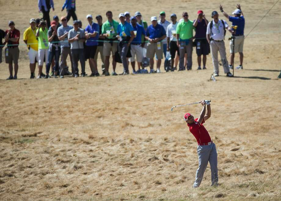 Sergio Garcia, shown hitting from the rough Friday, got into a salty exchange with fans Saturday. Photo: Dean Rutz, McClatchy-Tribune News Service