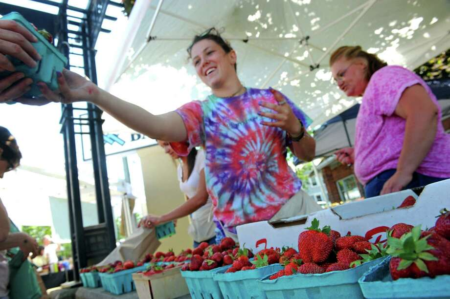 Anna Buhrmaster of Buhrmaster Farms sells strawberries at the Upper Union Street Strawberry Fest & Art Show on Saturday June 20, 2015 in Schenectady, N.Y.  (Michael P. Farrell/Times Union) Photo: Michael P. Farrell / 00032312A