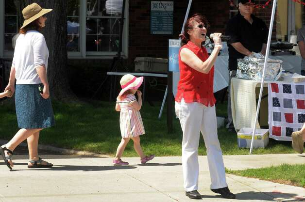 Leslie Maiello of Pop Pop's Pesto sing the  national anthem to open the days events at the Upper Union Street Strawberry Fest & Art Show on Saturday June 20, 2015 in Schenectady, N.Y.  (Michael P. Farrell/Times Union) Photo: Michael P. Farrell / 00032312A