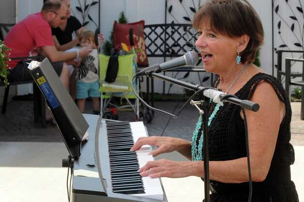 Noreen Pratt sings, Moondance, in front of Sondra's Fine Jewelry at the Upper Union Street Strawberry Fest & Art Show on Saturday June 20, 2015 in Schenectady, N.Y.  (Michael P. Farrell/Times Union) Photo: Michael P. Farrell / 00032312A
