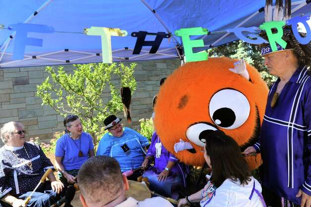 The Smile Monster breaks into a Voice of The Grove drum circle during the Upper Union Street Strawberry Fest & Art Show on Saturday June 20, 2015 in Schenectady, N.Y.  (Michael P. Farrell/Times Union) Photo: Michael P. Farrell / 00032312A