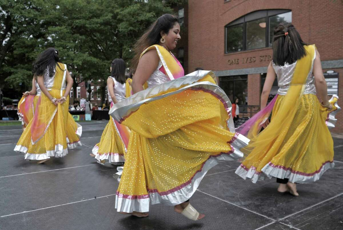 Dancers from the Bollywood Dance Factory perform on stage at the World of Colors concert on the Danbury CityCenter Green, hosted by the World Heritage Cultural Center on Saturday.