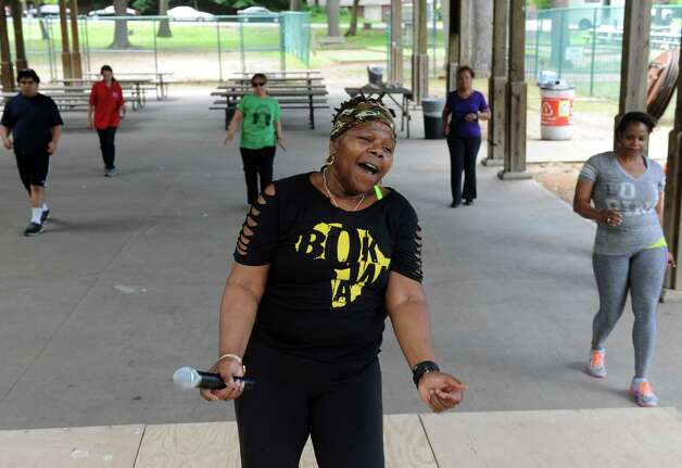 Omoye Cooper of Schenectady leadsa group in a African form of dance aerobics caled Bokwa during the Hamilton Hill Arts Center 15th annual celebration of Juneteenth at Central Park on Saturday June 20, 2015 in Schenectady, N.Y.  (Michael P. Farrell/Times Union) Photo: Michael P. Farrell / 00032311A