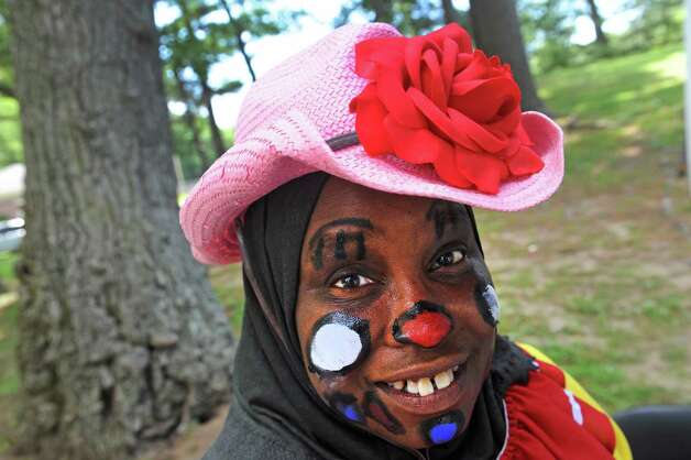 Shireen Ali entertains as a clown at the Ahmadiyya Muslim Comminity booth during the Hamilton Hill Arts Center 15th annual celebration of Juneteenth at Central Park on Saturday June 20, 2015 in Schenectady, N.Y.  (Michael P. Farrell/Times Union) Photo: Michael P. Farrell / 00032311A