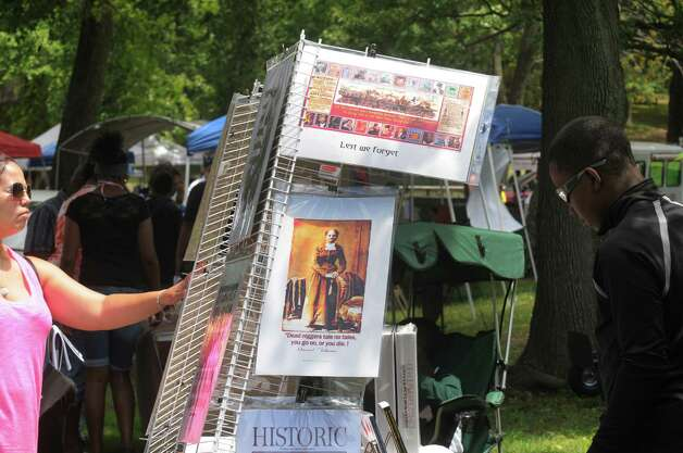 Vendors set up booths during the Hamilton Hill Arts Center 15th annual celebration of Juneteenth at Central Park on Saturday June 20, 2015 in Schenectady, N.Y.  (Michael P. Farrell/Times Union) Photo: Michael P. Farrell / 00032311A